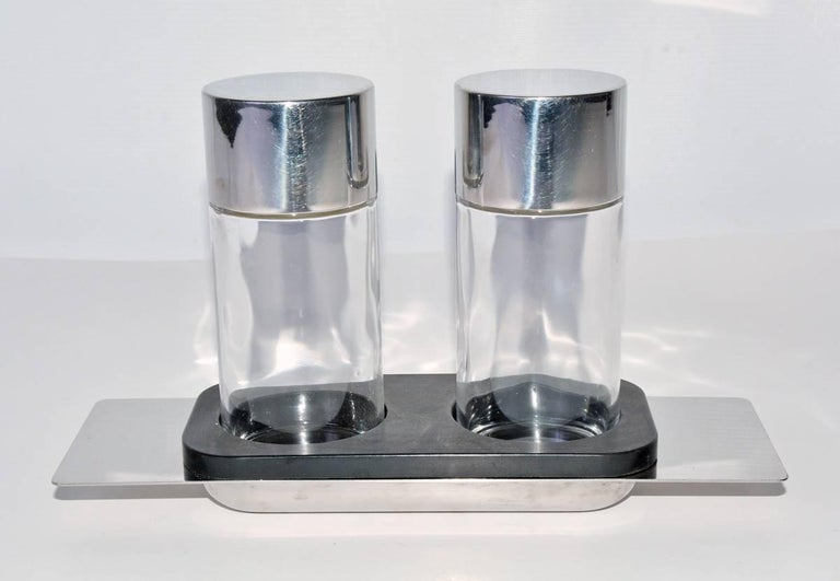"A masterfully designed modernist oil and vinegar cruet set of impeccable quality made of glass and polished metal by Cini & Nils, Italy, 1970s. 5.75"" high. In great condition with some minor wear.  Measures: Bottle, diameter 2"", height"