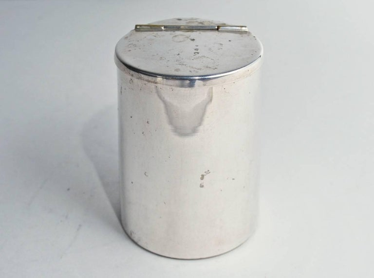 The small vintage silver plated canister or storage box has a fully hinged lid.