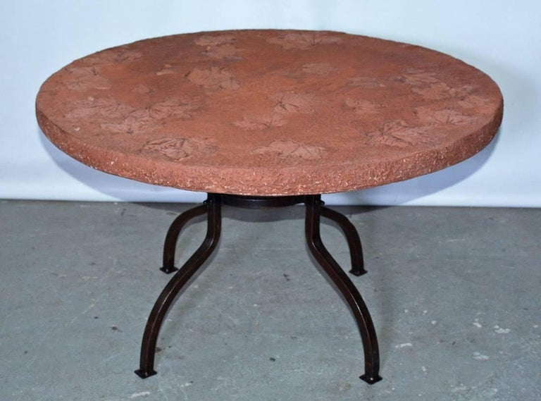 Organic cast stone top with leaf design on contemporary cast iron metal base coffee table. Wonderful patina. Great to use indoor or outdoor on porch patio or in the garden. Measures: Metal base - D 18.13