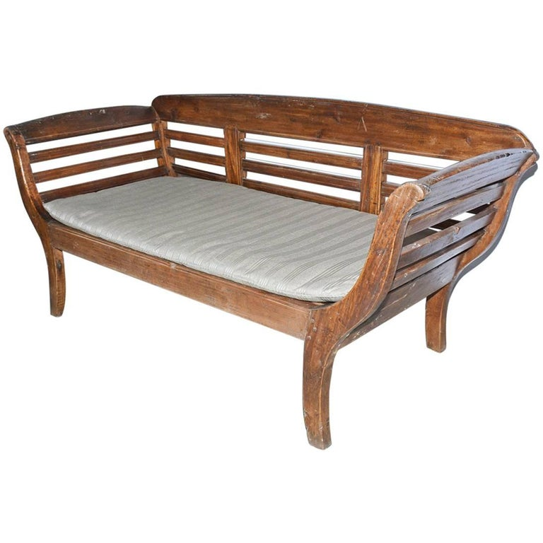 Antique Teak Settee with Slatted Back, Arms and Cushion For Sale