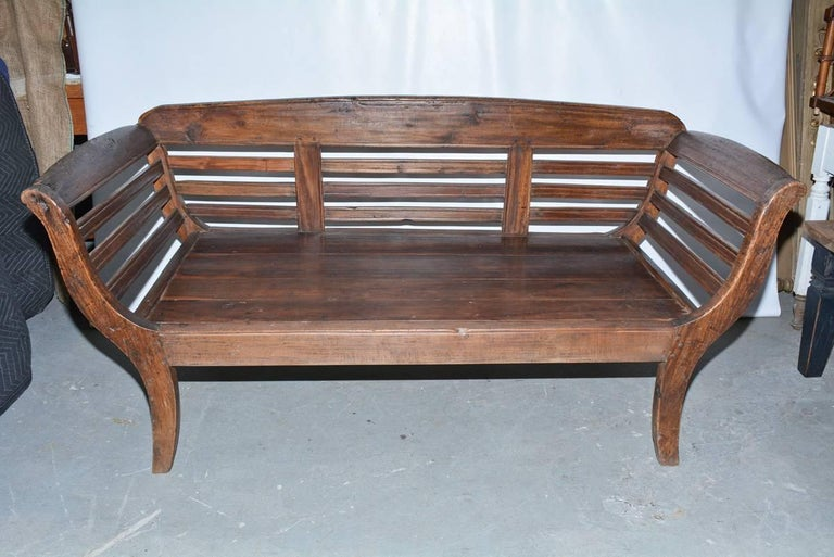 British Colonial Antique Teak Settee with Slatted Back, Arms and Cushion For Sale
