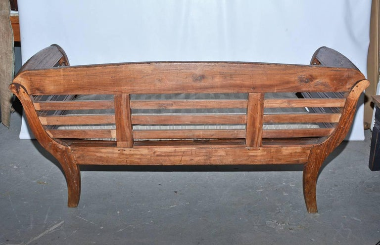 Antique Teak Settee With Slatted Back Arms And Cushion