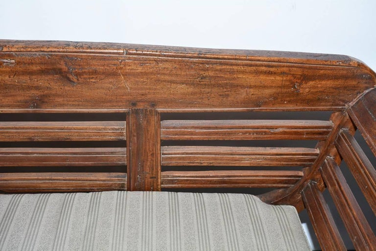 Antique Teak Settee with Slatted Back, Arms and Cushion In Good Condition For Sale In Great Barrington, MA