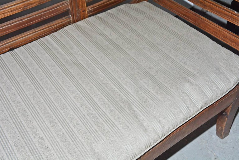 Antique Teak Settee with Slatted Back, Arms and Cushion For Sale 1