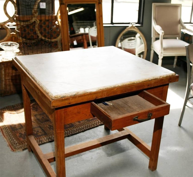 French kitchen worktable with marble top. Perfect in a kitchen. Marble has wonderful distressed quality.  Center island, butcher block and baker's table.