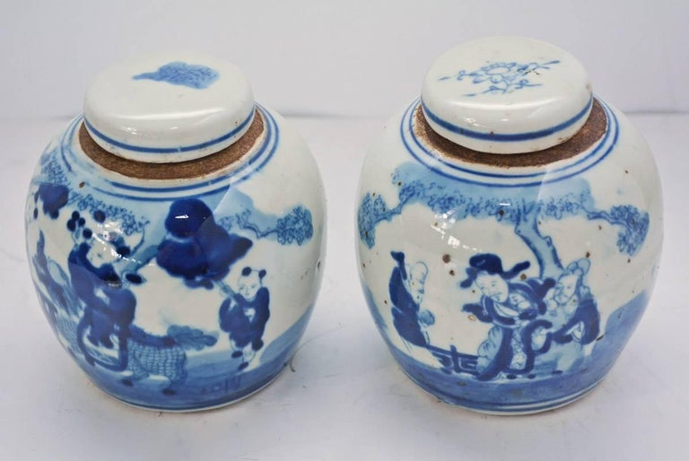 Pair of petite 19th century blue and white ginger jars. The pair has a beautiful, all-over figure decoration.