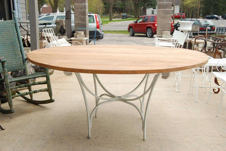 Teakwood tabletop made with reclaimed wood and vintage metal base. Table can be used indoor or outdoor, garden or porch table. Top and base can be sold separately. Table top is 1