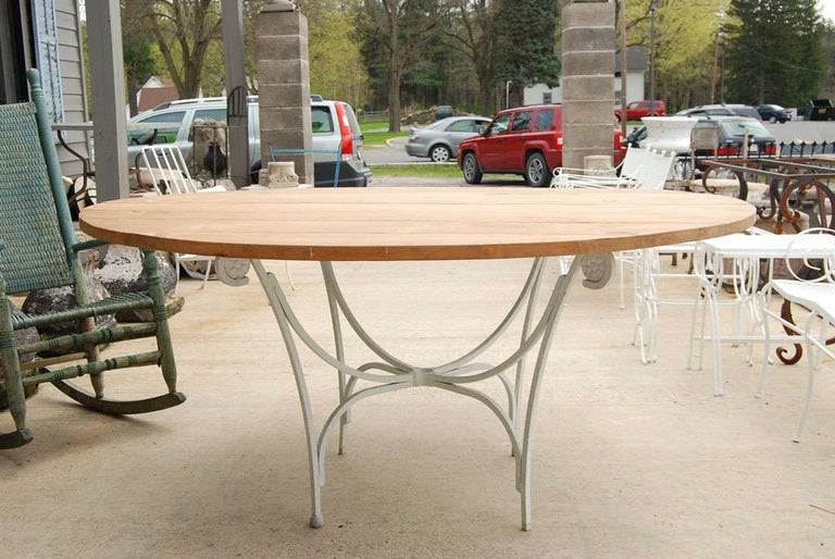 Neoclassical Indoor or Outdoor Round Teak and Metal Base Garden Dining Table For Sale