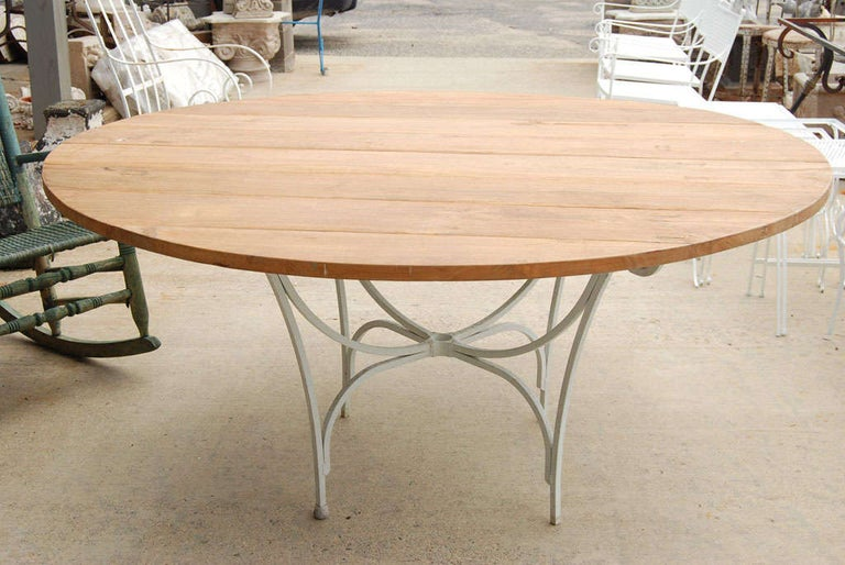 Dutch Indoor or Outdoor Round Teak and Metal Base Garden Dining Table For Sale