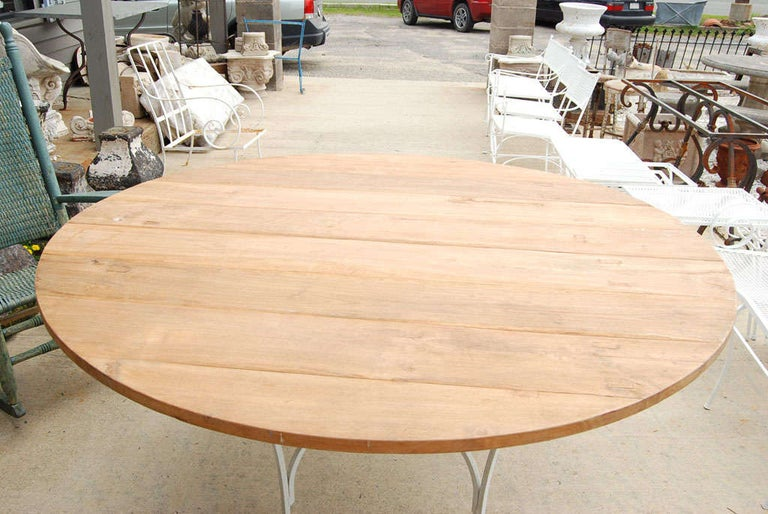 Indoor or Outdoor Round Teak and Metal Base Garden Dining Table In Good Condition For Sale In Great Barrington, MA