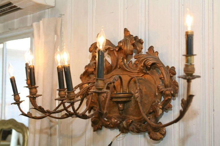 Fabulous giltwood seven-arm Italian wall sconce. Great as a wall decoration, above a bed or in any room.