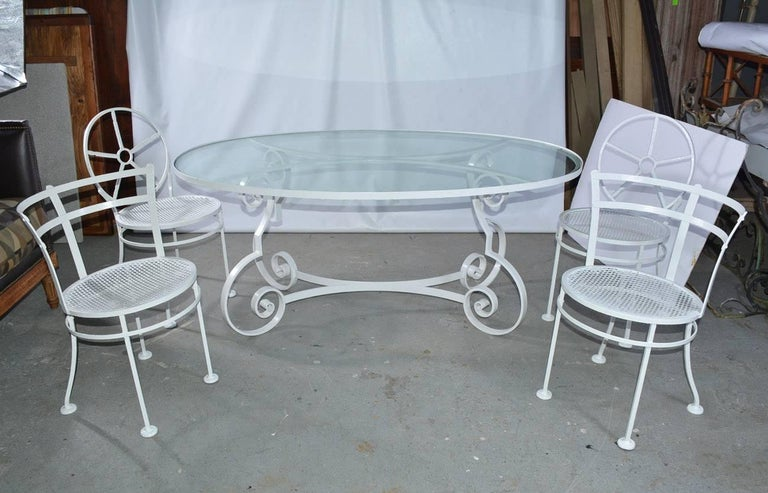 Mid-Century Modern Oval Metal and Glass Midcentury Patio/Porch Garden Table and Four Dining Chairs For Sale
