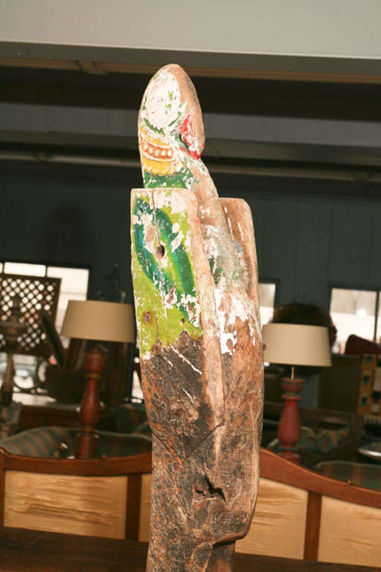 Antique carved and decorated nautical ship's figurehead, circa 1890, depicting a regal Primitive bird with a beak. The sculpture is in original paint. Although there has been much paint loss and age cracks, they all contribute to the charm of this