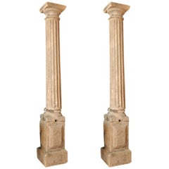 Pair of Early French Stone Columns on Plinths