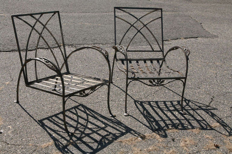 Pair of stylish wrought iron metal armchairs. Can be used indoor or outdoor. They are not identical but close enough. Dimensions of chair #2: 33 H x 26 L x 30 D.