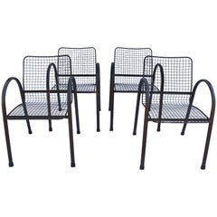 Four Patio Wrought Iron Mesh Armchairs