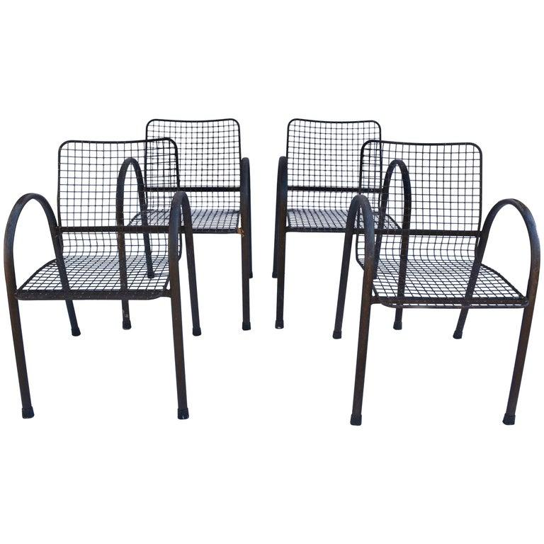 Four Patio Wrought Iron Mesh Armchairs