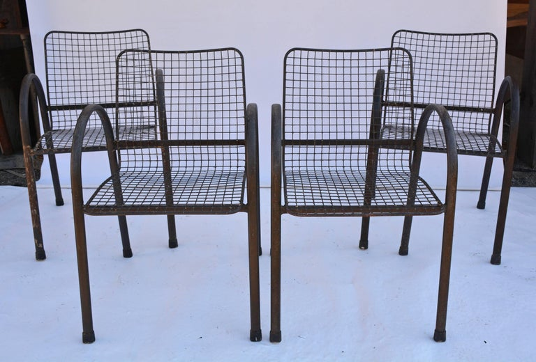 Set of four U-shaped arms metal garden dining armchairs with airy wire mesh seats and backs attached to cross bars. Great for patio, porch dinging and seating, very comfortable!