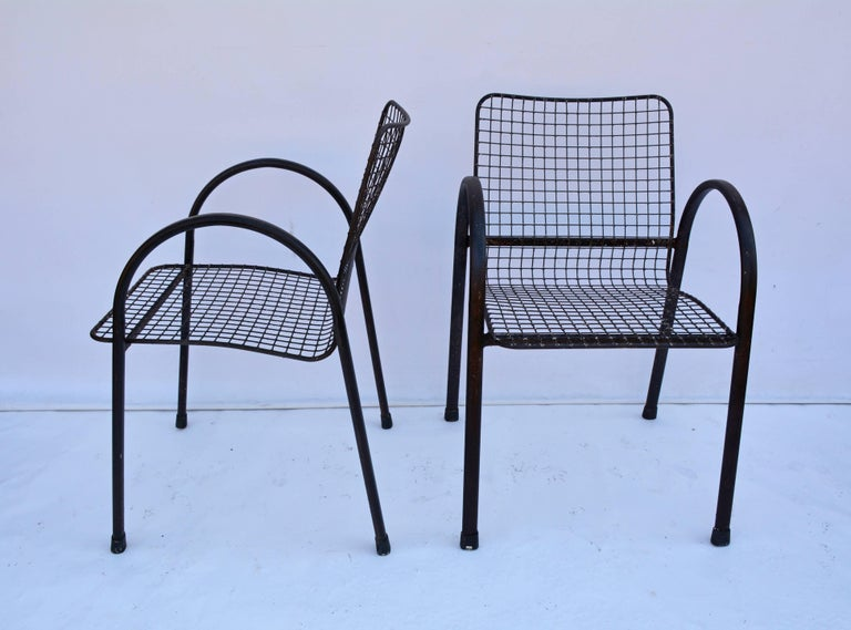 Four Patio Wrought Iron Mesh Armchairs In Fair Condition For Sale In Great Barrington, MA