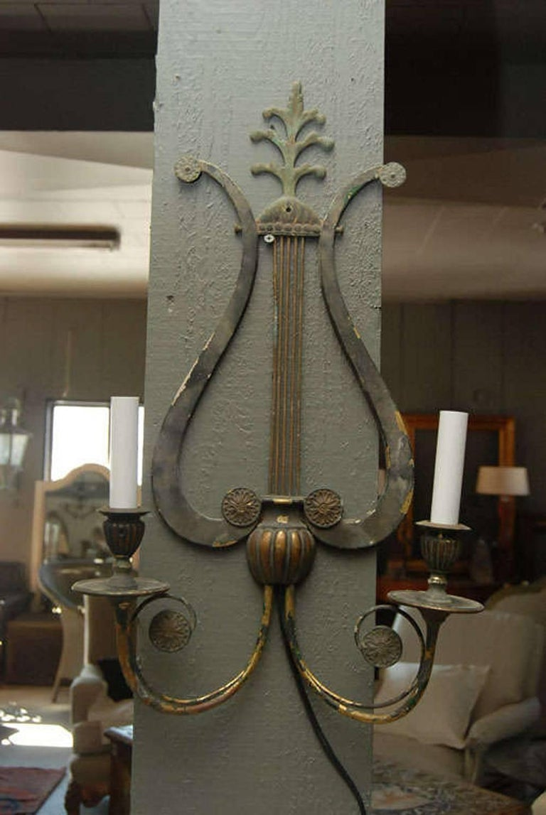 Wonderful patina wall sconce in musical clef design. Newly rewired.