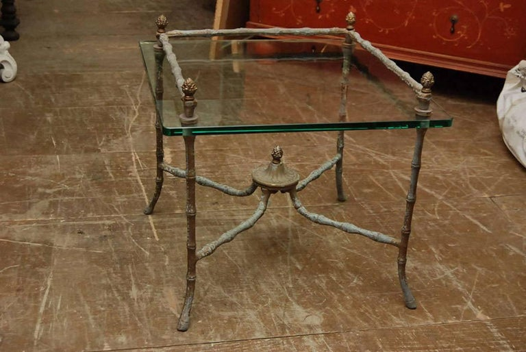 Pair of Giacometti inspired side tables with 1/2 inch glass top and wonderful patina.