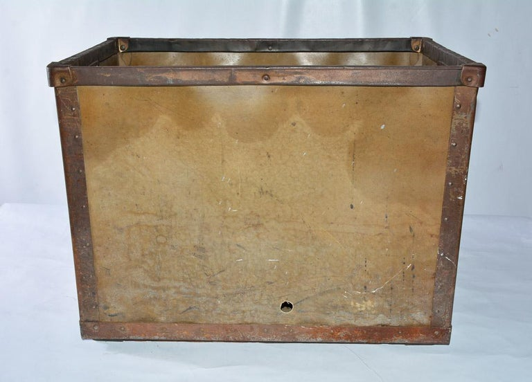 Made by Kennett, this Industrial style mail cart has two-hole handles with iron braces and metal studs. These were used for sorting mail. Can be used for laundry or children's toys and just any objects hanging around for storage or display.