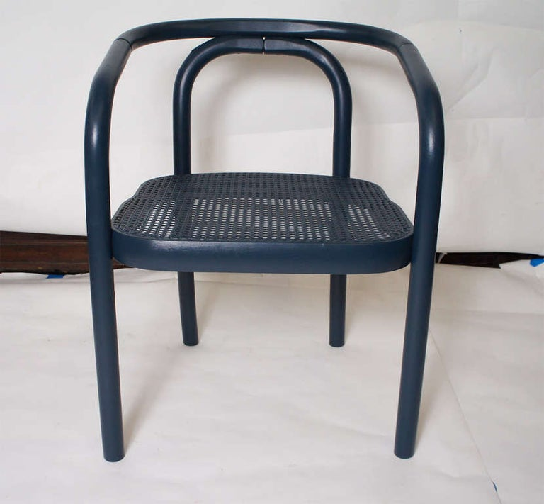 Midcentury dark blue, navy painted armchairs.  Keywords: dining chairs.