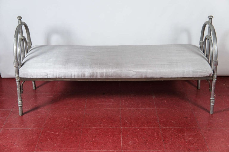 Metal bench frame with silver moire upholstered cushion. Perfect for foot of the bed or entry foyer.