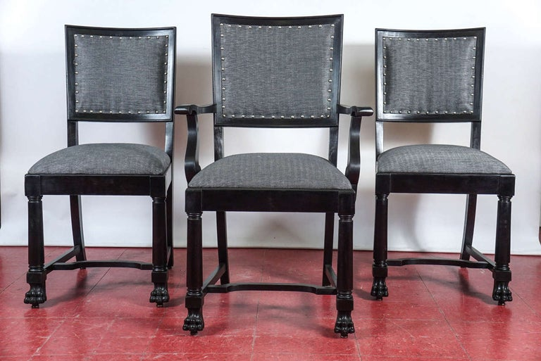 Set of six vintage mahogany dining chairs including two armchairs and four side chairs. Newly re-upholstered in handsome black and white herringbone linen seats and backs with nailhead trim. Measures: seat, 18