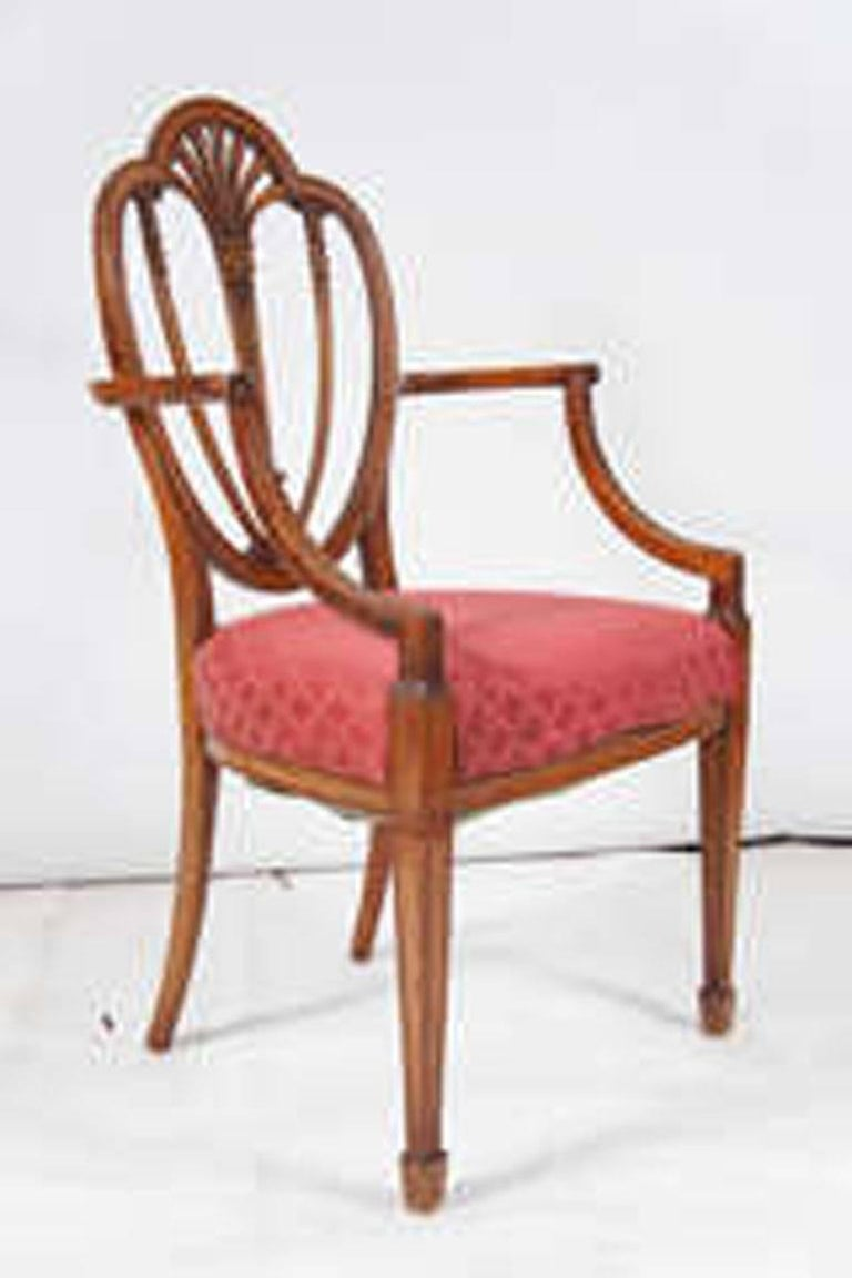 Supreme elegance in the style of the work of England's great 18th century neoclassical architect and interior designer Robert Adam. Glorious carving. Excellent chair for a desk or extra seating.  Measure: Arm height is 29