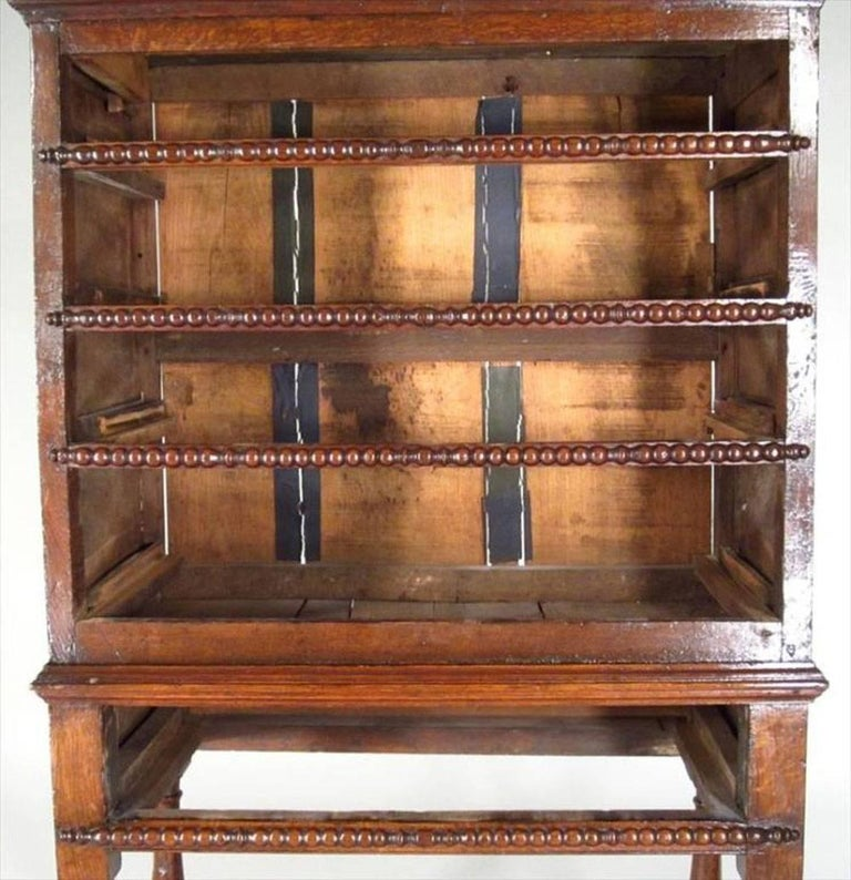 English Jacobean oak chest on later stand, chest fitted with four graduated drawers, on stand with baluster supports with block stretchers.