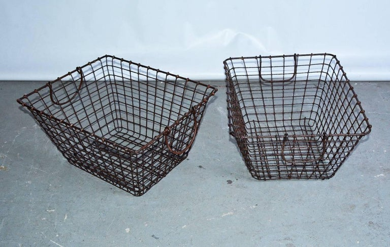 The sturdy vintage baskets are made of soldered wire and each has two round moveable handles. Sold singly. Great for holding collections of toys where they can be seen from any angle and the baskets are lightweight for carrying.