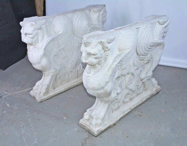 Two grand and very impressive cast concrete neoclassical style pedestal dining table bases with finely detailed winged griffins. Will support a large stone, marble or glass table top. Can be used indoors or outdoors - sun porch, solarium,