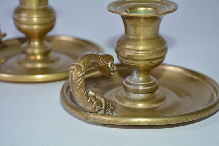 Regency Pair of Antique Brass Candleholders with Dolphin Handles For Sale