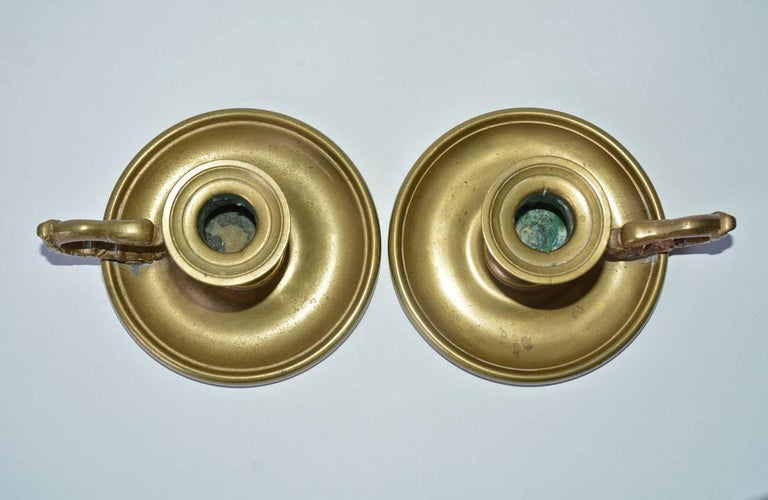 Hand-Crafted Pair of Antique Brass Candleholders with Dolphin Handles For Sale