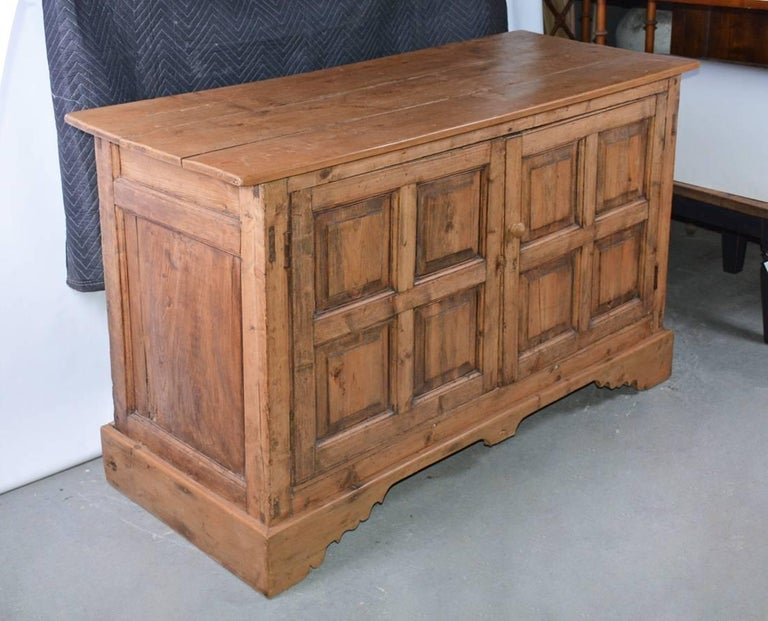 Large antique Welsh buffet server or sideboard with two four-paneled doors. There is a rustic, informal or country look about the piece. For storing away the TV?