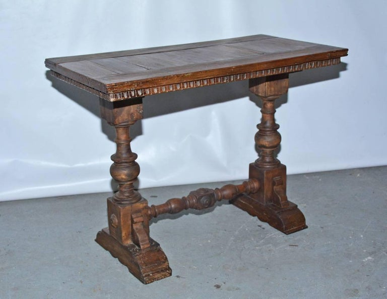 Excellent early English Jacobean side or end table for lamps with turned legs and trestle base.  Could also be used as a small stylish table for eating in front of the TV.  Consider it as a hall table.