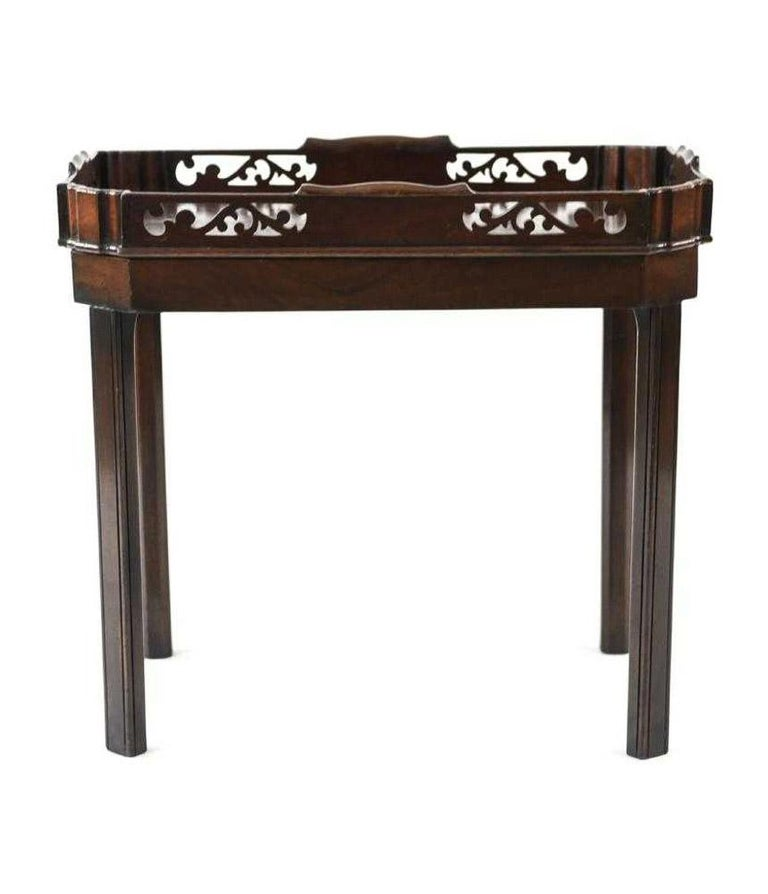 The circa 1800 English Georgian tray on contemporary base are made of solid mahogany. The tray is decorated with panels of fretwork. Perfect as a tea table, side table or occasional table.