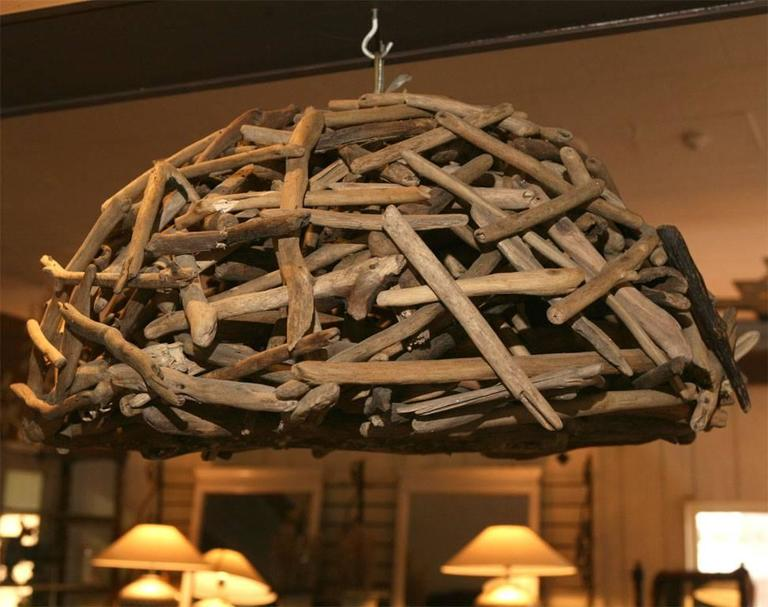 Natural applied driftwood hanging lighting fixture. Can be sold individually.