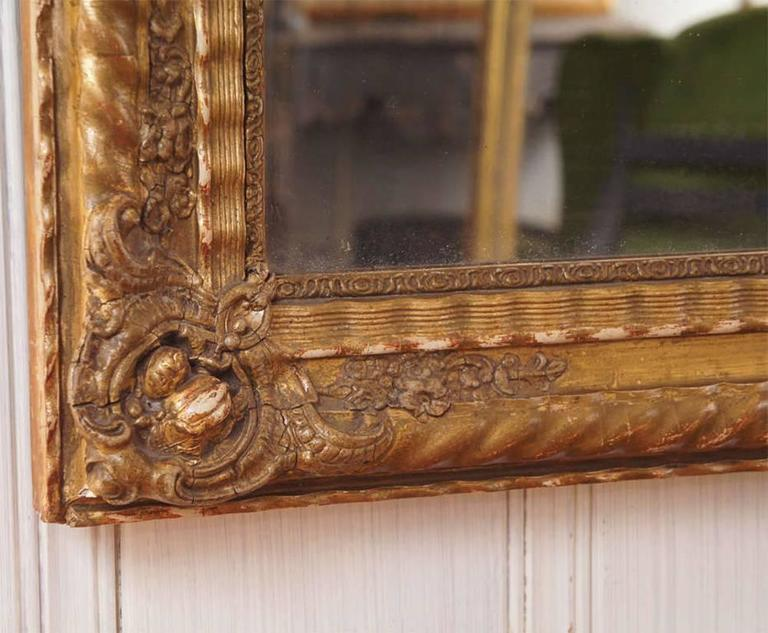 Rectangular French mirror 19th century gesso with gilt undulating and rope design. Can be hung vertically or horizontally, for mantel or fireplace. Original mirror.