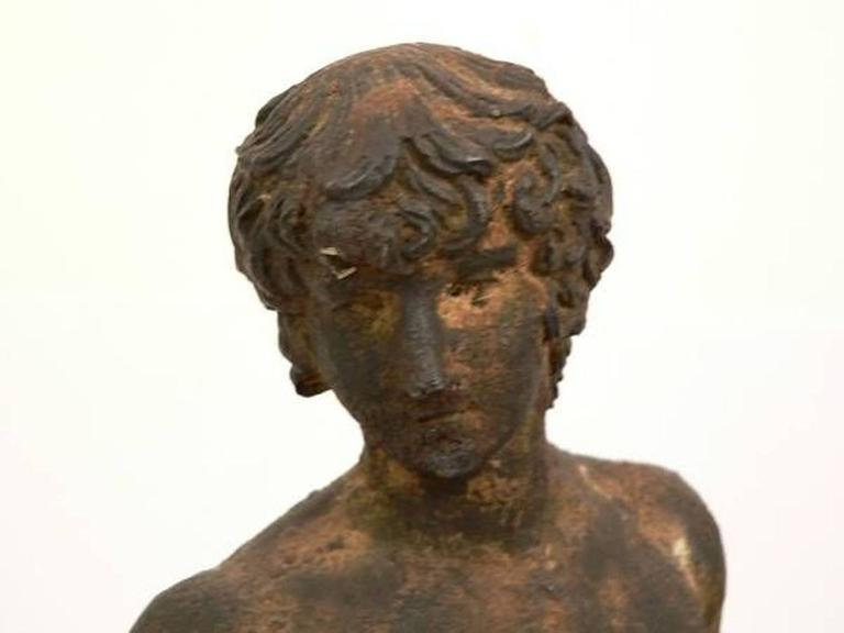 A 19th century classical bronze statue of a male nude on beveled slate base, wonderful aged patina, unsigned.