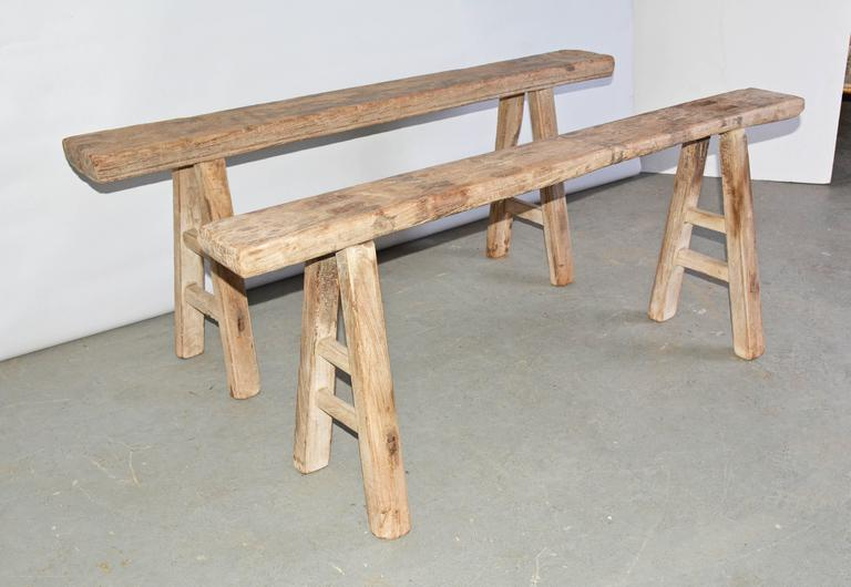 The antique Chinese benches have splayed legs pegged into each seat. The legs are secured with double stretchers also pegged. Each slightly different. Can be used as dining seating, porch or picnic casual dining.