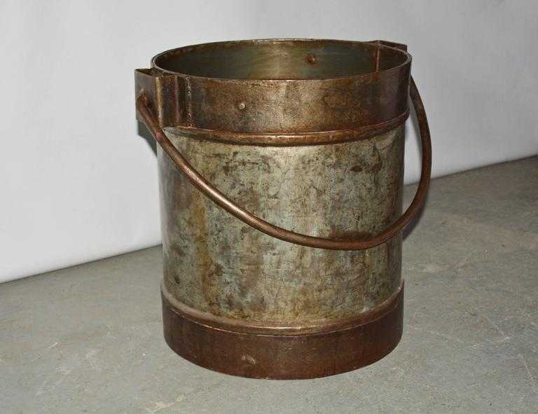 Wonderful antique Industrial iron metal bucket can be used for logs and kindling or put a piece of glass, wood or stone on top and use as a side or end table.