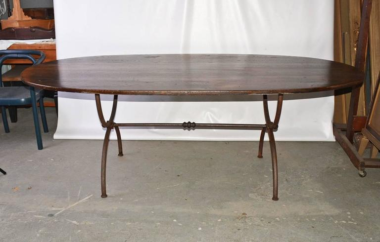 Elegant and rustic at the same time, oval wrought iron base dining table. Iron shows rust but can be removed and coated to protect. Oak has been distressed to add patina and character. Top and base can be sold separately. $2800 top/$2800 base.  We