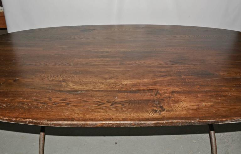 Oval Metal Base and Wood Top Dining Table In Excellent Condition For Sale In Great Barrington, MA
