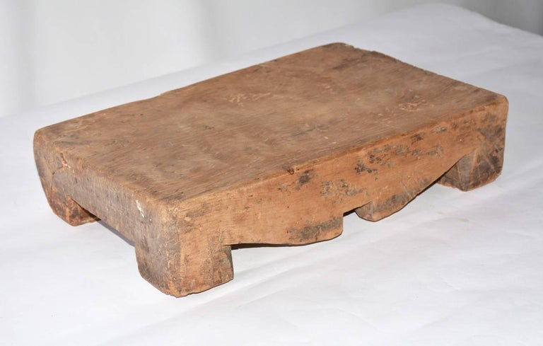 Early Chinese chopping block or cheese board in one large piece of wood.