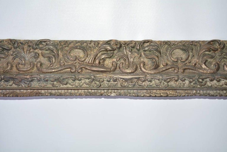 The Renaissance-style wood carved and gilt frame has a molded design with flourishes of leaves and scrolls. Can be used for painting or a mirror.