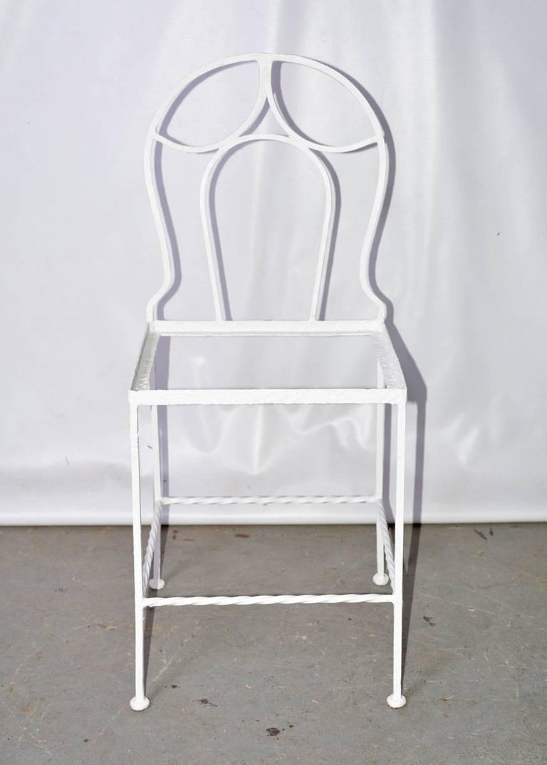 The French metal bistro side chair has a decoratively curved back and an inset seat frame for the padded cushion of your choice.
