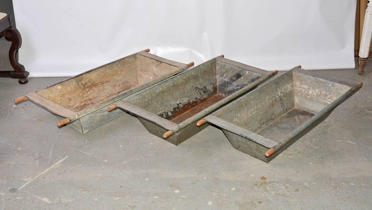 Large galvanized iron troughs with wood handles sold