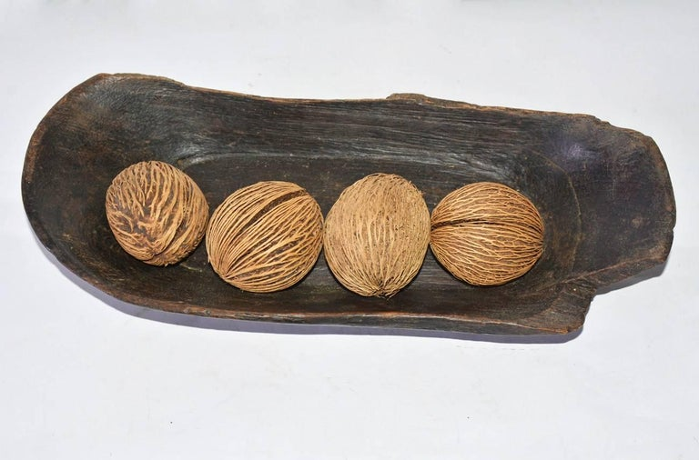 Rustic carved wood bowl with four decorative balls makes a great centerpiece for any table. Same price with or without balls.